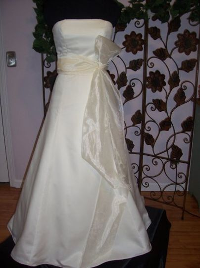 several layers of tulle petticote attached to the lining, and a satinribbon sash to finish.