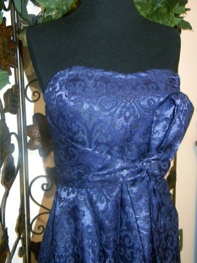 Absolutley stunning! This gown has many hourd of hand applique and beading work in it. The flower...