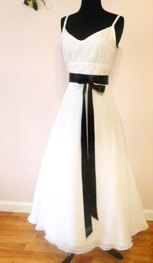 This lovely gown is tea length, chiffon with a lace insert at the waist