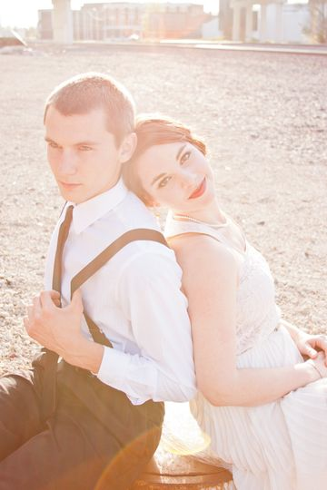Black tie engagement session with that stunning sunset at the railroad tracks.
