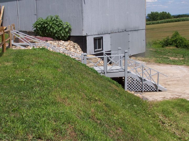 Stairway with rock wall and walk-out landing
