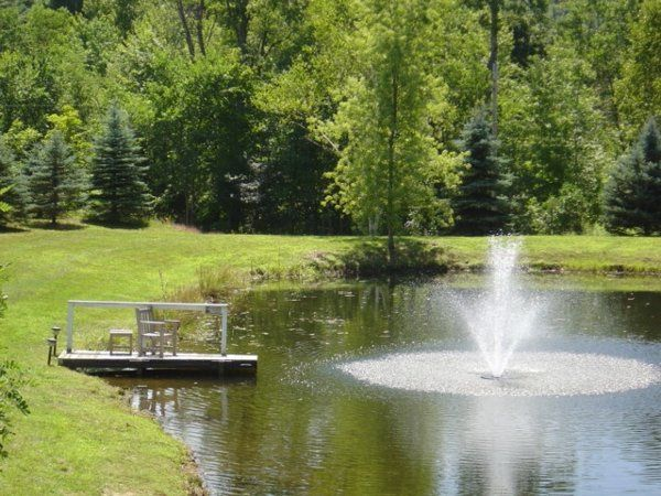 The dock and pond fountain provide a nice backdrop for the wedding ceremony.