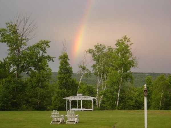 Backyard rainbows often appear, to the delight of our wedding guests.