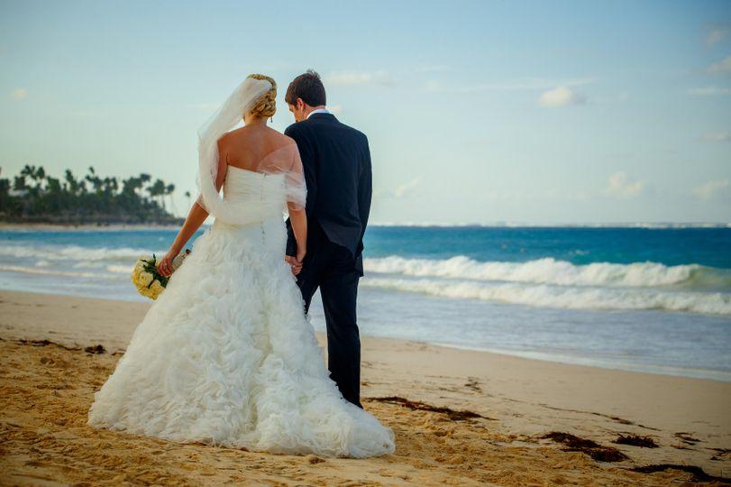 1329858dc2bc9bfb bride groom walking along beach
