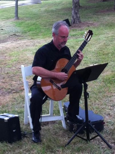 classical guitar on the grounds of Chaumette Winery in Ste. Genevieve