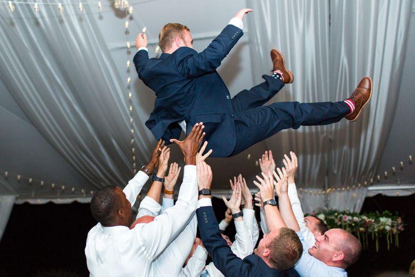 Guests throwing groom