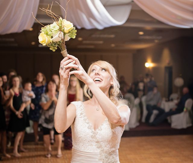 upclose of mollie with bouquet throwing