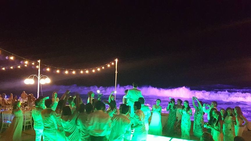 Illuminated dance floor, string lights and Colorful lighting for the sea
