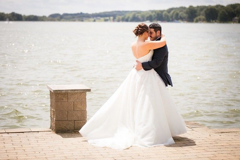 Newlyweds by the water | Photo credit: Adam Michaels Photography