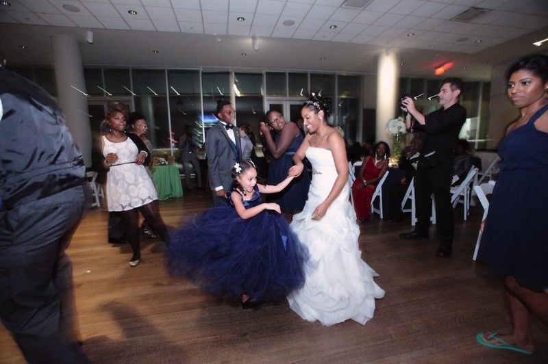 Dancing guests and bride