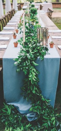 Greenery garland plus soft candlelight