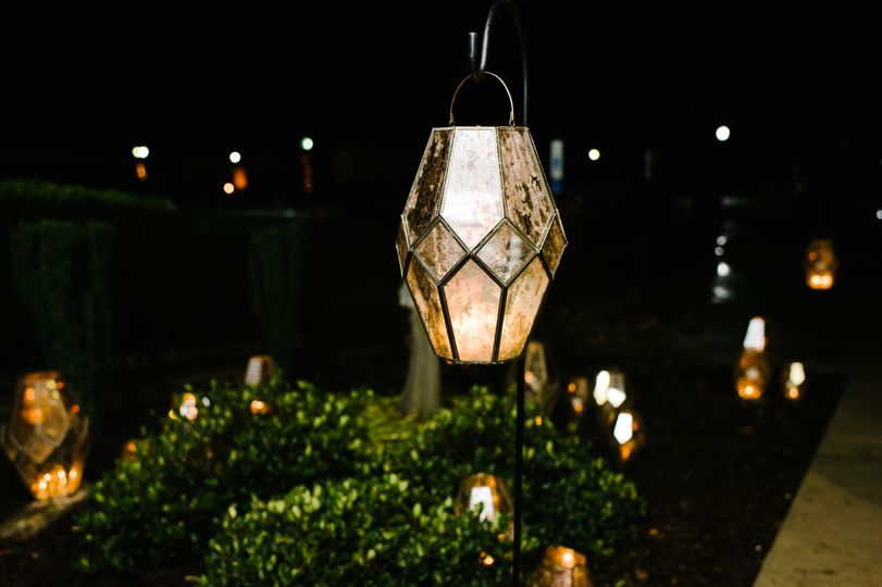 Lanterns in flower bed