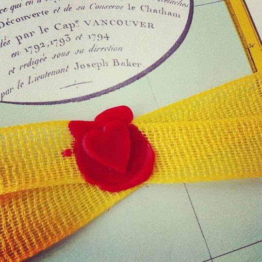 A wax seal on a destination wedding invite by Ladyfingers Letterpress!