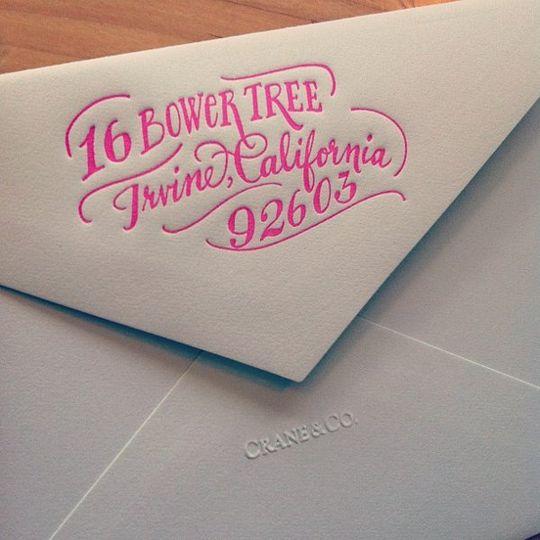 Some neon addresses on a celadon envelope by Ladyfingers Letterpress!