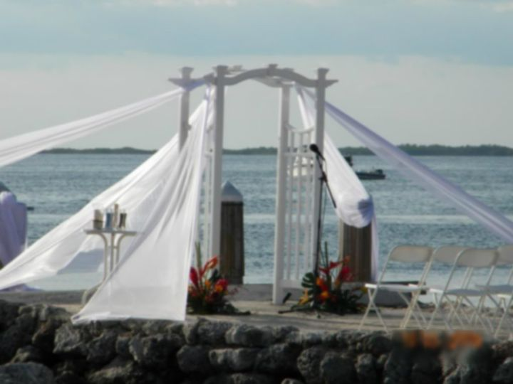 This beautiful arch can be decorated any way you want for your very special wedding day.