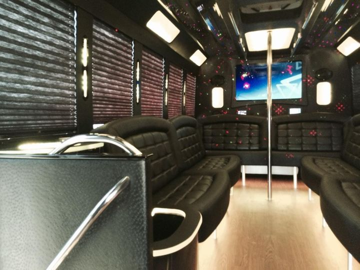 Limo bus interiors with removable dance pole