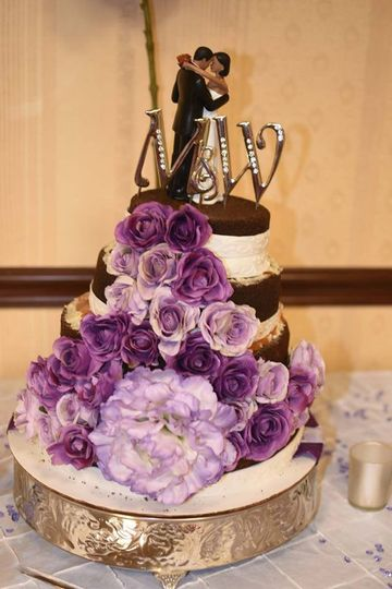 Organic Wedding Cake: Black Chocolate Cake. Wallnuts, caramel, white chocolate between layers