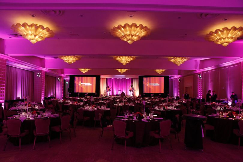 Large hotel ballroom wedding reception with awesome pink uplighting, video projection system, and DJ...