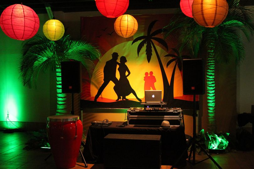 Miami themed wedding reception in a museum with LED uplighting, illuminated globes, and custom...