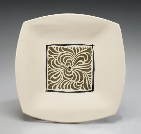 A single avocado swirl square accented with black is the focal point of this creamy stoneware...