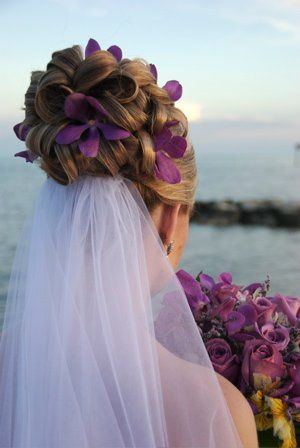 Stunning hair and makeup by Casa Salon.  Purple orchid hair flowers.