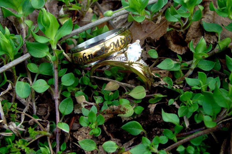 Wedding rings in the grass by the beach