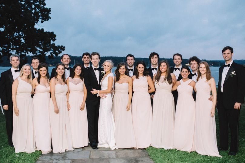 Couple with wedding attendants
