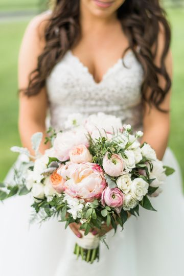 Peonies and Ranunculus in bridal bouquet.