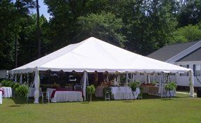 Classic pole style wedding tent.  Catherdal window curtains and leg drapes are also available.