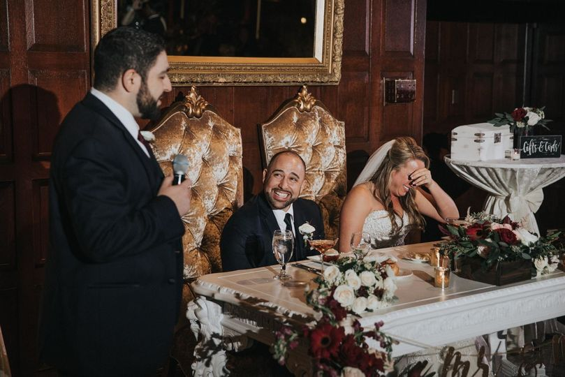 bride and groom react to toast wedding reception