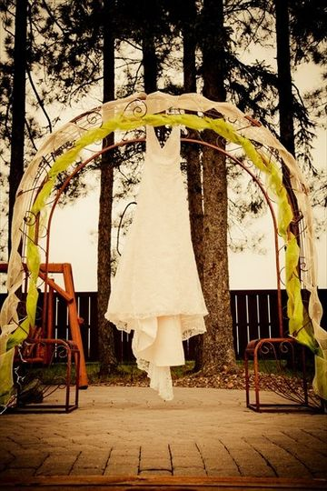 Timeless Moments PhotographyWedding Arch at Pine Peaks Event Center