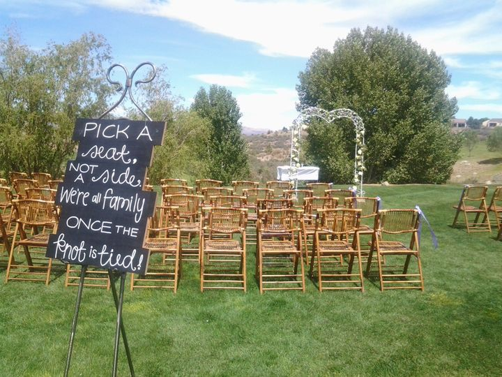 Outdoor wedding set-up with natural bamboo chairs