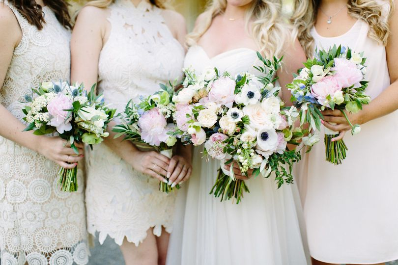 Bride with her bridesmaid holding bouquets