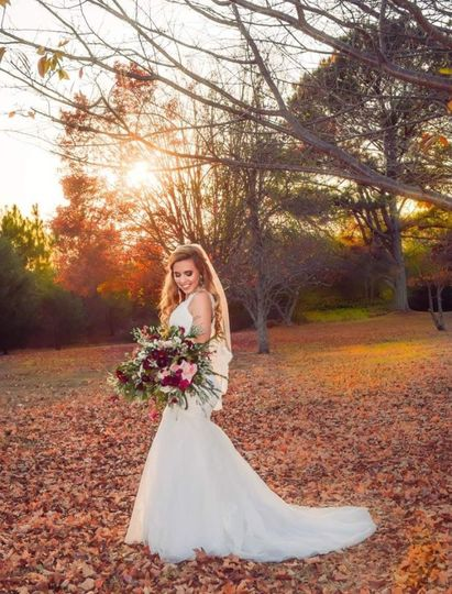 Bride holding her bouquet outdoors