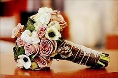 Old fashioned roses with velvet ribbon and a camio to complete this wintery look.