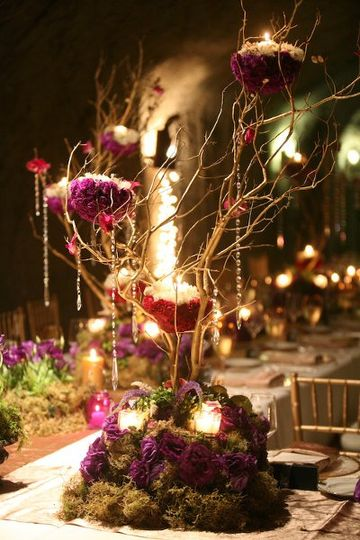 Dramatic branch arrangment, with flower nests for the candles.
