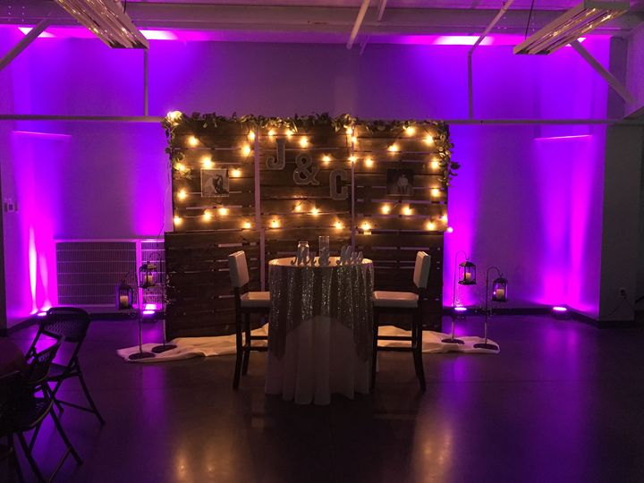 Rustic backdrops and pink uplights