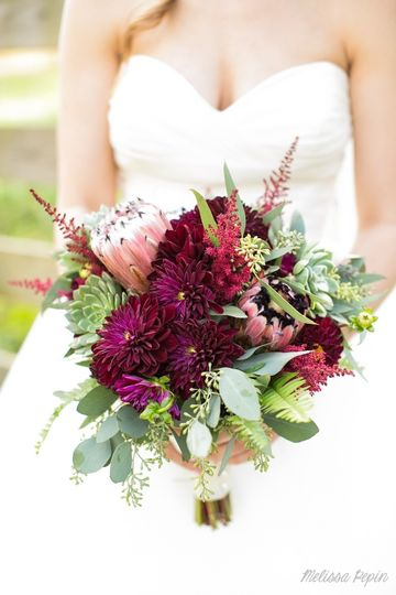 Protea and burgundy dahlias