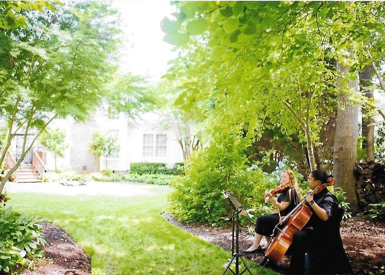 String duo in backyard