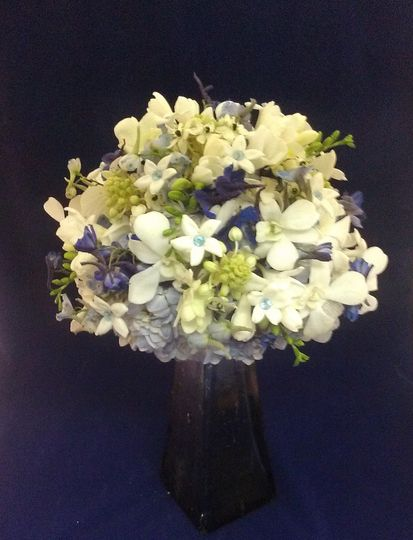Blues and whites are the stars of this bouquet featuring hydrangeas, dendrobium orchids, star of...