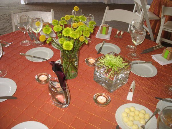 Centerpiece grouping- floating green spider mum in square vase, green yoko ono mums with crespedia...