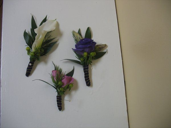Boutonnieres: White miniature calla lily, purple lissianthus, hot pink spray roses- all with green...
