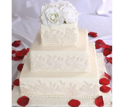 Tiered square fondant cake with fondant lace pattern and fondant pearls.
