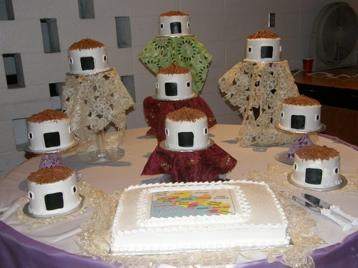 "African theme wedding reception.  Little huts are cake covered with buttercream icing and ""straw"" is..."