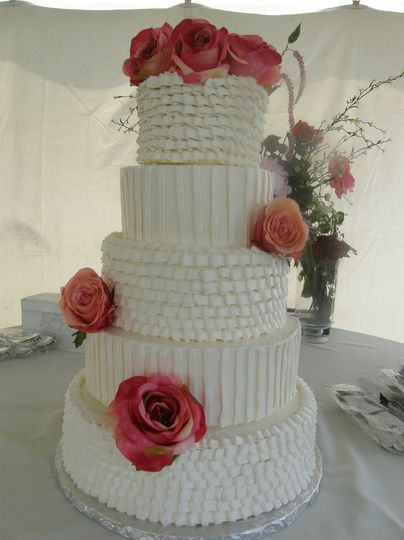 Buttercream tiered cake with alternating pattern design.