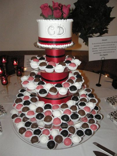 "Individual cake bites with 6"" cake with monogram initials and ribbon."