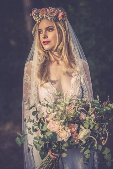 Gorgeous bride holding her bouquet