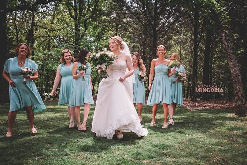 Bride and bridesmaids in a park | Photo credit Miranda Longoria Photography
