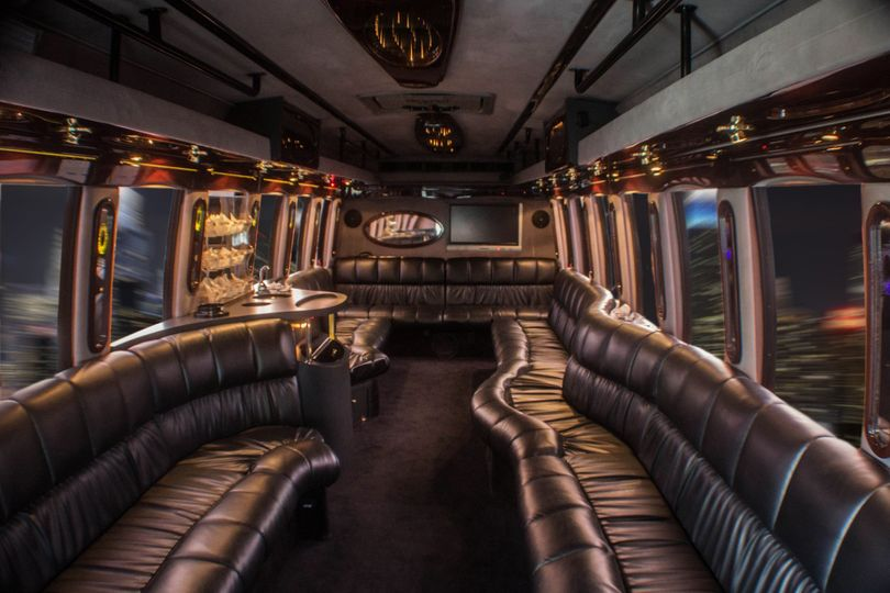 24 passenger luxury / party bus in silver. Perfect for bridal party or guest transportation. These...