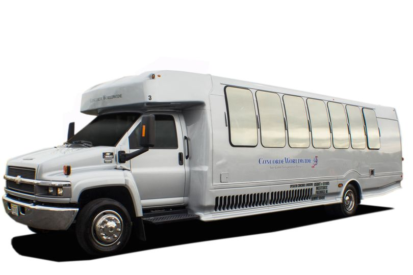 Exterior of 24 passenger luxury / party bus in silver. These roomy and comfortable minibuses have...